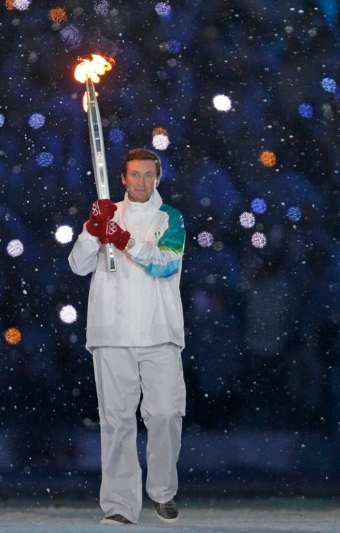 . Wayne Gretzky is seen carrying the Olympic torch during the opening ceremony for the Vancouver 2010 Olympics in Vancouver, British Columbia, Friday, Feb. 12, 2010. (AP Photo/Gerry Broome)