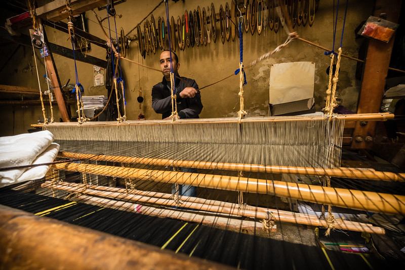 Genevieve Hathaway_Morocco_Fez_Medina_Man working on loom_2.jpg