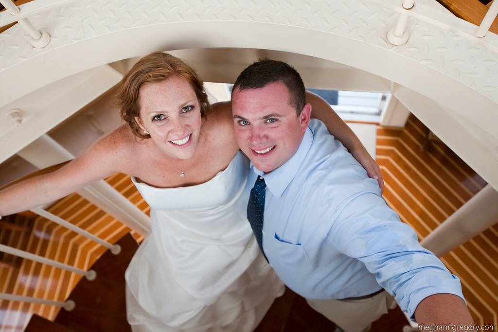 Bride and groom take a photo in the lighthouse at Nautics. (Photo by Meghann Gregory Photography) - Nauticus Marina - The Casual Gourmet, Cape Cod Wedding Caterer