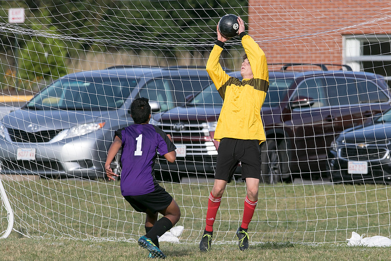 Trivium High School boys soccer played South Lancaster Academy on Thursday afternoon in Lancaster. Trivium's goalie Charlie Dalsass jumps for the ball. SENTINEL & ENTERPRISE/JOHN LOVE