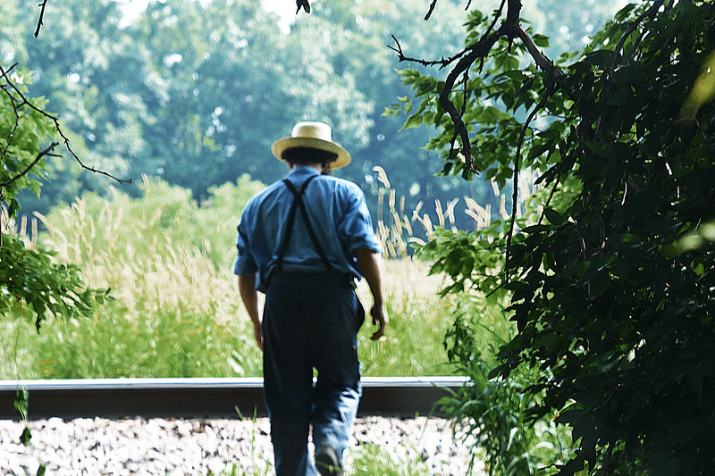 05 Amish man waiting for the Big Boy steam engine-Roper..jpg