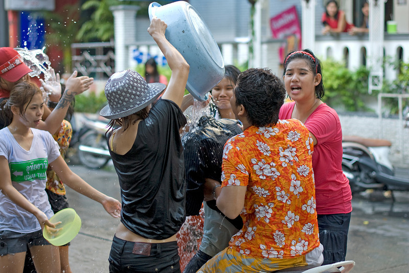 Lots of water being poured onto a man at the 2010 Songkran Festival