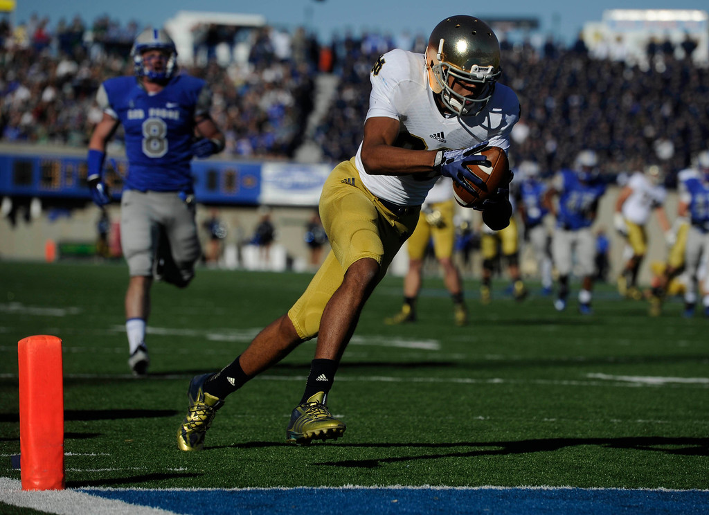 . COLORADO SPRINGS, CO - OCTOBER 26: Corey Robinson, Notre Dame, scores a touchdown against Jared Jones, left, and the Air Force Falcons in the first quarter of play at Falcons Stadium Saturday afternoon, October 26, 2013. (Photo By Andy Cross/The Denver Post)