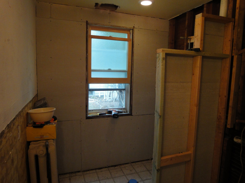 Outside wall ready for mud, tile and a new glass block window.