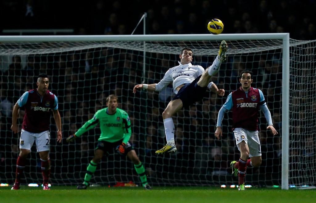 . Tottenham Hotspur\'s Gareth Bale, second right, attempts an overhead kick during the English Premier League soccer match between West Ham and Tottenham Hotspur at Upton Park stadium in London, Monday, Feb. 25, 2013.  (AP Photo/Matt Dunham)