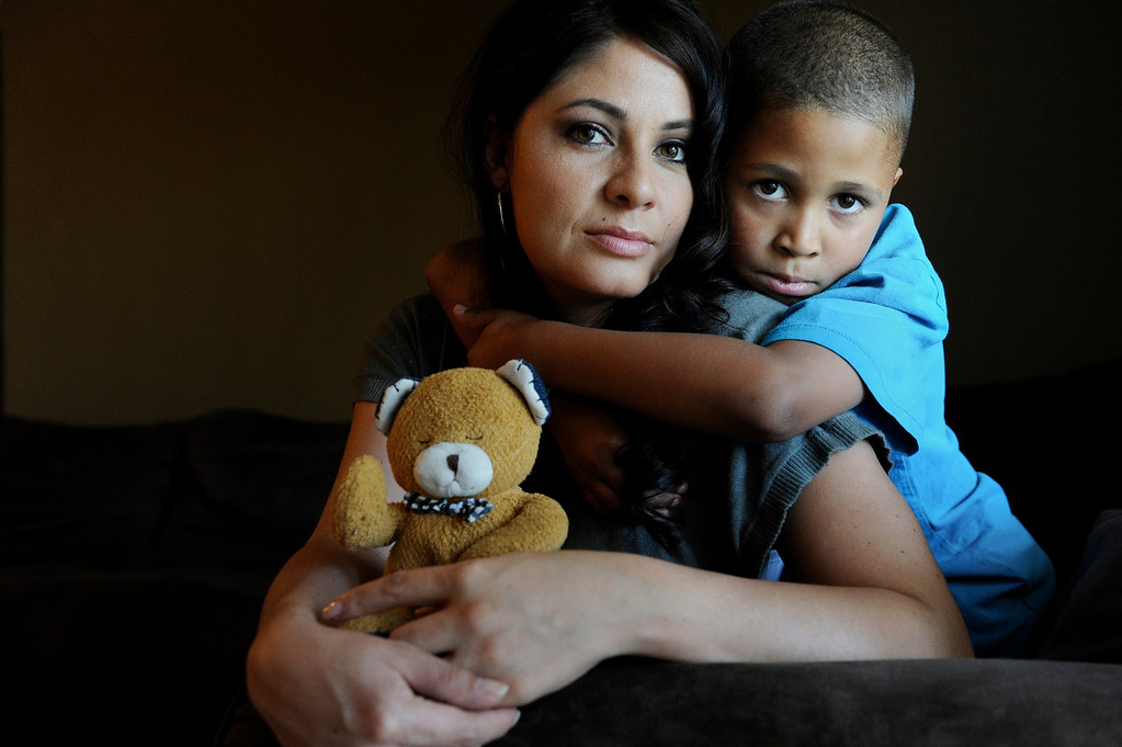 . Amee Espinoza and her son, Isaiah Austin, pose for a portrait with a teddy bear that belonged to her other son, Jeremiah Saunders, at their home in Aurora, CO, Wednesday July 12, 2012. Jeremiah was at Dammi Seneviratne�s Denver day care when he died on Nov. 4, 2010. When Senevirante left Jeremiah alone in the basement. The 17-month-old was rushed to Children�s Hospital where he was pronounced dead. But investigators found evidence that Jeremiah sat unattended after he died, according to a state and county review of the boy�s death. Craig F. Walker, The Denver Post