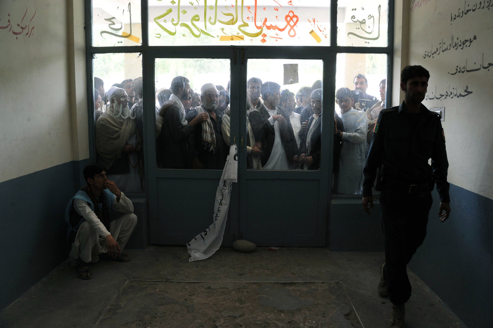 . Afghan voters wait outside a polling station in Jalalabad on April 5, 2014. Afghan voters went to the polls to choose a successor to President Hamid Karzai, braving Taliban threats in a landmark election held as US-led forces wind down their long intervention in the country.  (Noorullah Shirzada/AFP/Getty Images)