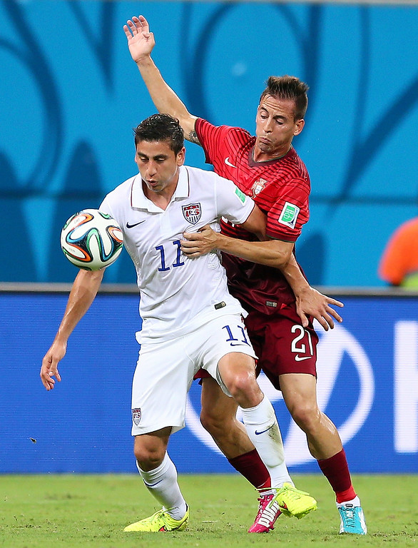 . Alejandro Bedoya of the United States is challenged by Joao Pereira of Portugal during the 2014 FIFA World Cup Brazil Group G match between the United States and Portugal at Arena Amazonia on June 22, 2014 in Manaus, Brazil.  (Photo by Kevin C. Cox/Getty Images)