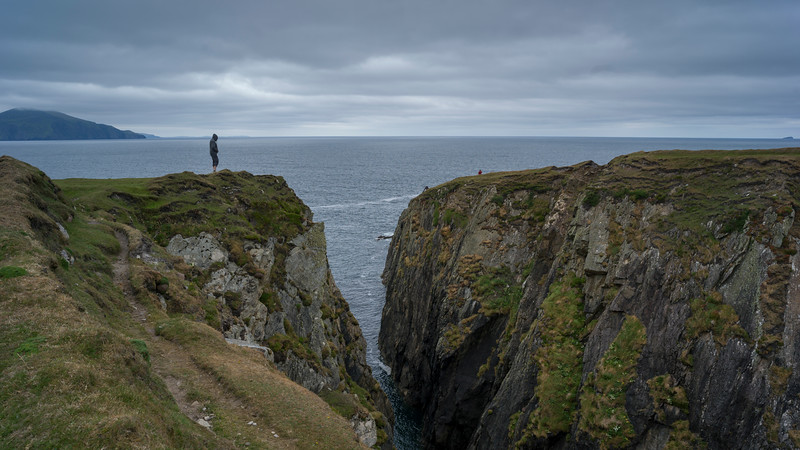 Person standing on cliff, Achill Island, County Mayo, Ireland