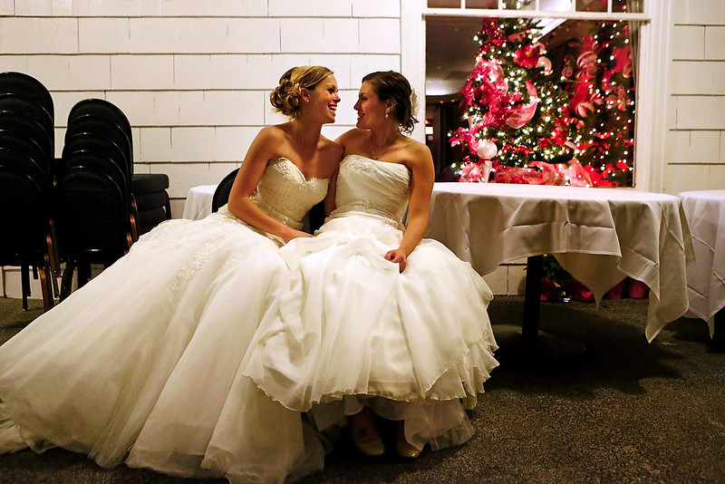 . Mary Davidson, 27, left, and her bride Monica Rozgay, 29, take a breather outside in advance of their official midnight ceremony at The Seattle Yacht Club early Sunday Dec. 9, 2012. Rozgay and Davidson, of Seattle, were among the first couples to wed following the passage of Referendum 74, which approved a bill legalizing same-sex marriage in the state of Washington. (AP Photo/The Seattle Times, Bettina Hansen)