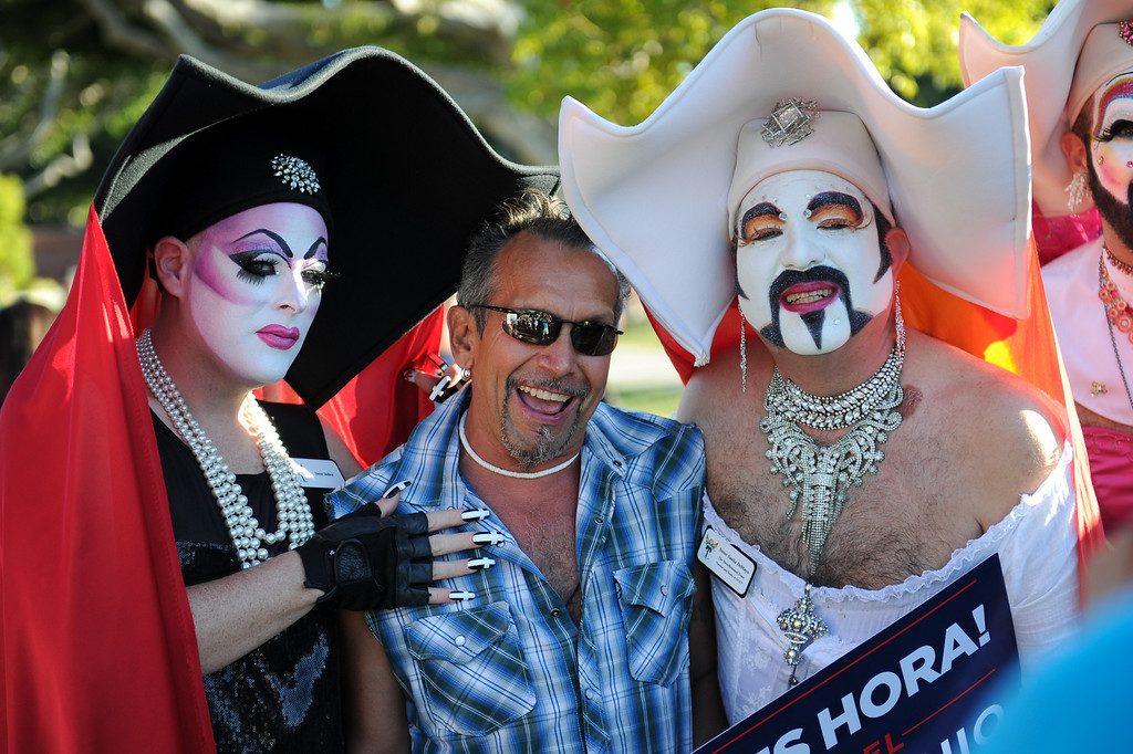 ". Lawrence Herrera, center, poses with ""Sister Indica,\"" left, and \""Sister Tootie Toot\"" at the rally in West Hollywood to celebrate the U.S. Supreme Court\'s ruling that killed Prop 8, Wednesday, June 26, 2013. (Michael Owen Baker/L.A. Daily News)"