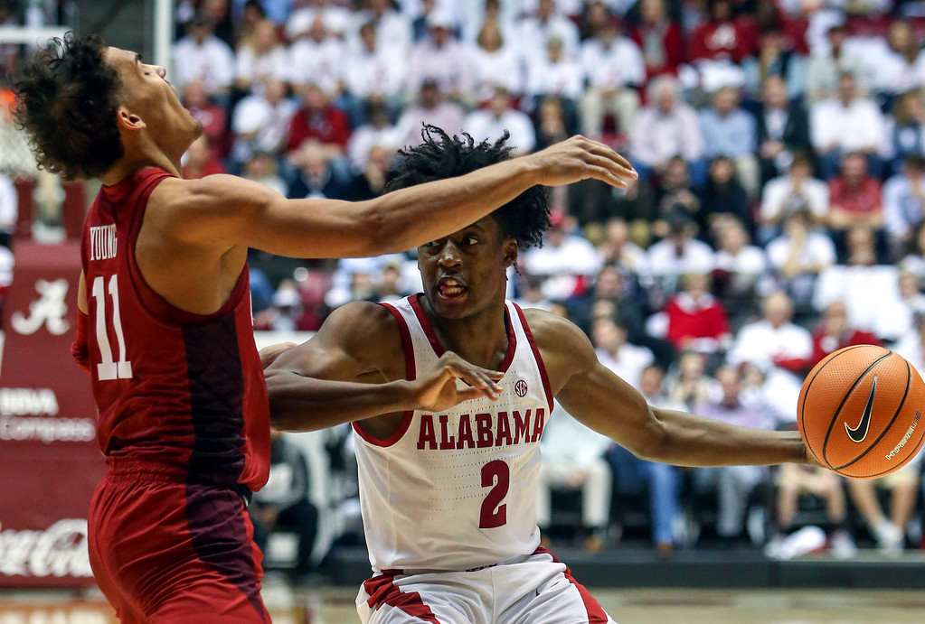 . Alabama guard Collin Sexton (2) is called for a foul as he tries to get around Oklahoma guard Trae Young (11) during the second half of an NCAA college basketball game, Saturday, Jan. 27, 2018, in Tuscaloosa, Ala. Alabama won 80-73. (AP Photo/Butch Dill)