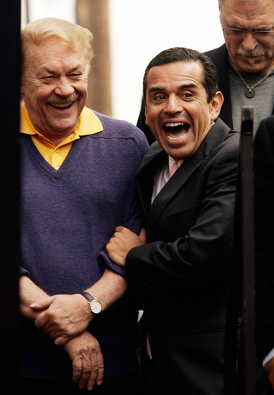 . Jerry Buss, left, owner of the Los Angeles Lakers, and Los Angeles Mayor Antonio Villaraigosa, right,  joke before Buss was honored with a television star on the Hollywood Walk of Fame in the Hollywood section of Los Angeles, Monday, Oct. 30, 2006. (AP Photo/Damian Dovarganes)