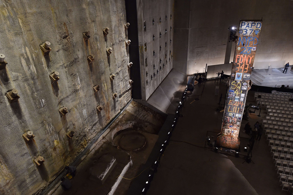 . The symbolic Last Column (R), a steel beam from one of the World Trade Center towers, stands near the Slurry Wall (L), which holds back the Hudson River waters, seen during a press preview of the National September 11 Memorial Museum at the World Trade Center site May 14, 2014 in New York. AFP PHOTO/Stan HONDA/AFP/Getty Images