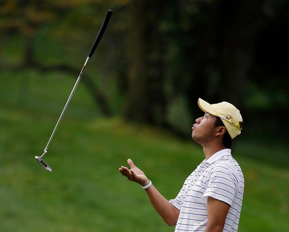 . International team player Hideki Matsuyama, of Japan, tosses his putter in the air after missing a birdie putt on the fourth hole during the four-ball matches at the Presidents Cup golf tournament at Muirfield Village Golf Club,  Saturday, Oct. 5, 2013, in Dublin, Ohio. (AP Photo/Darron Cummings)