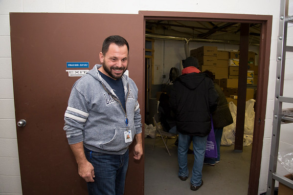11/25/19 Wesley Bunnell | StaffrrThanksgiving meals were distributed by HRA workers and volunteers on Monday evening at their Osgood Park location. David DeGrand, part of a volunteer group from Hexcel Corporation, smiles after helping a group with their bags of food.