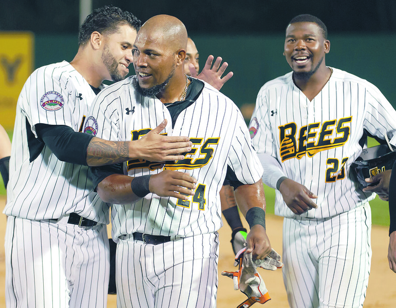 05/04/18  Wesley Bunnell | Staff  The New Britain Bees held opening night at New Britain Stadium on Friday night against the Road Warriors. Deibinson Romero (24) is congratulated by teammates after hitting a game winning single in the bottom of the 10th to give the Bees their first victory of the season.