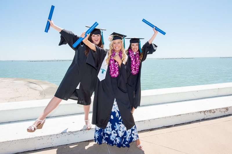 Kelsey Thompson (left), Brianna Brink, and Raydean Mata. Over 1,100 graduates received their degrees during two commencement ceremonies held on May 13.