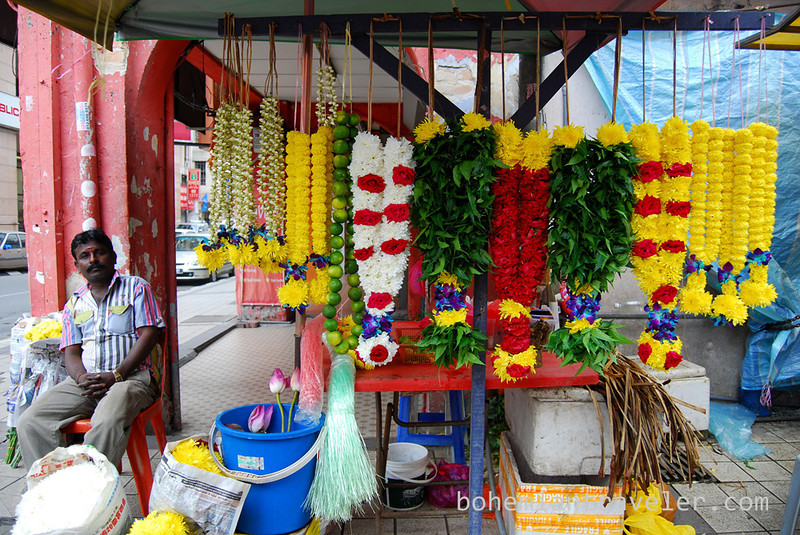 selling flowers outside a Hindu Temple in China Town KL Malaysia.jpg