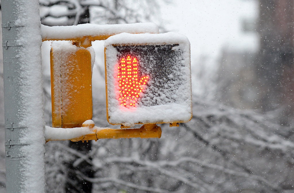 . Snow falls over a street sign in New York, March 8, 2013. AFP PHOTO/EMMANUEL DUNAND/AFP/Getty Images