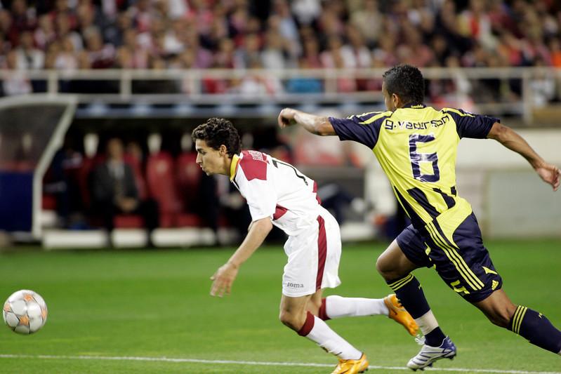 Jesus Navas pursued by Gökçek Vederson. UEFA Champions League first knockout round game (second leg) between Sevilla FC (Seville, Spain) and Fenerbahce (Istambul, Turkey), Sanchez Pizjuan stadium, Seville, Spain, 04 March 2008.