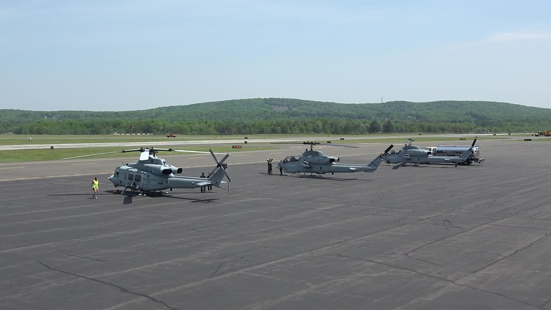 5-25-18...AH-1 Cobras and UH-1 Huey landing and taking off after performing flyover in Agawam in honor of Sir Francis Drake