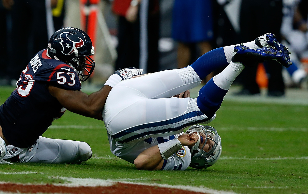 . Andrew Luck #12 of the Indianapolis Colts is sacked by Bradie James #53 of the Houston Texans in the first half of the game at Reliant Stadium on December 16, 2012 in Houston, Texas.  (Photo by Scott Halleran/Getty Images)