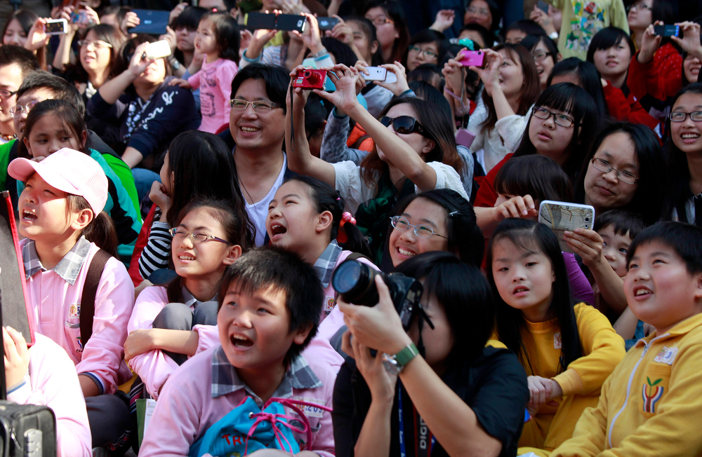 Description of . Students react during the countdown to when many believe the Mayan people predicted the end of the world, Friday, Dec. 21, 2012, in Taichung, southern Taiwan. (AP Photo/Wally Santana)