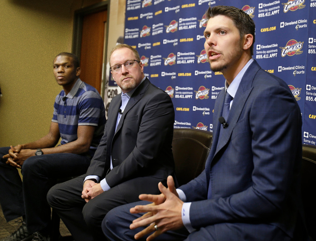 . Cleveland Cavaliers\' Mike Miller, right, answers questions during an NBA basketball news conference as general manager David Griffin, center, and James Jones listen Wednesday, Aug. 6, 2014, in Independence, Ohio. Miller and Jones came to Cleveland to help LeBron James win an NBA title. (AP Photo/Tony Dejak)