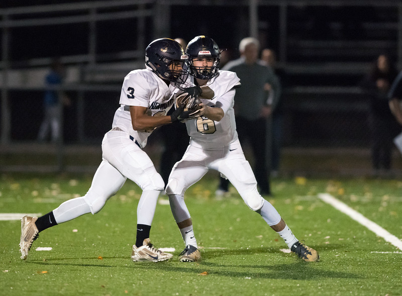 11/01/18  Wesley Bunnell   Staff  Newington football vs Maloney at Falcon Field in Meriden on Thursday evening. QB Nicholas Pestrichello (6) hands off to Dylan Nees-Fair (3).