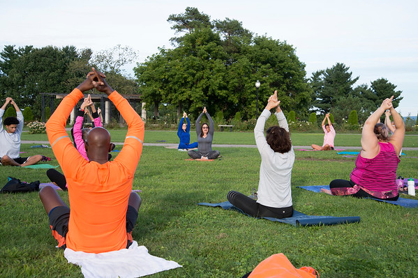 08/27/19 Wesley Bunnell | Staff Yoga in the Park is holding their last week of summer session classes with fall sessions slated to start in September through October. The program was put together by Kelly Murphy from Samatva Wellness in Berlin, the NB Parks and Recreation Department and the New Britain Health Department. Instructor Jocelyn Rivera, middle, leads the class.