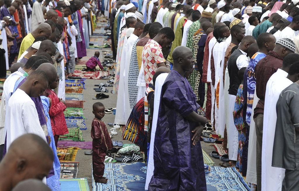 . Muslim faithfuls pray as part of the Eid al-Adha, also known in Ivory Coast as the Tabaski, on October 15, 2013 in Adjame, a popular district of Abidjan. AFP PHOTO/ SIA KAMBOU/AFP/Getty Images