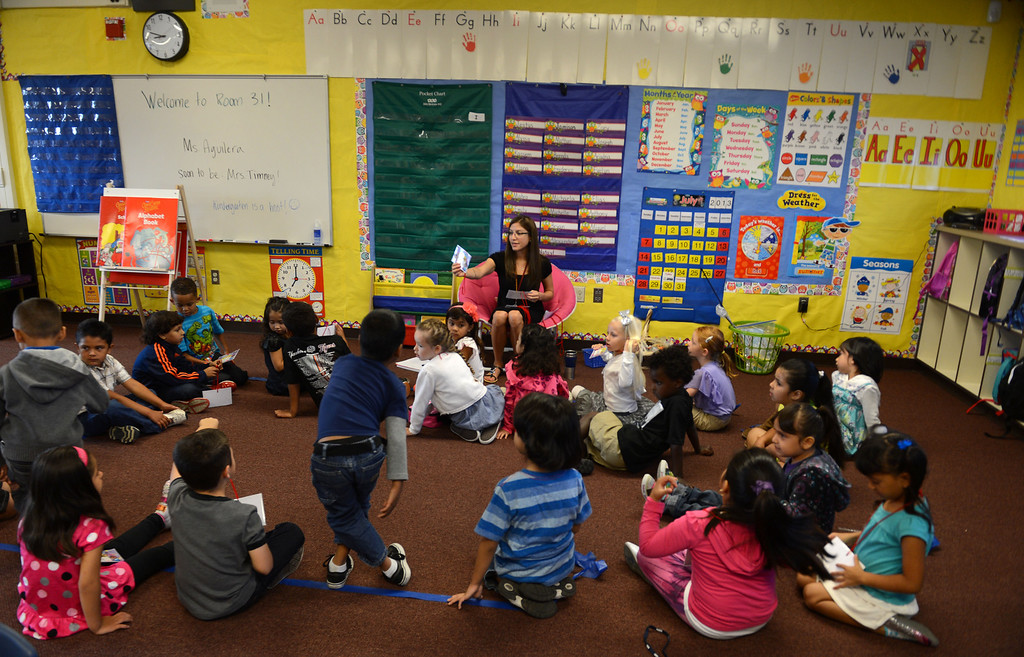 . Ms Claudia Aguilera calls out students names in her kindergarten classroom on the first day of school at Mary Casey Black Elementary School in Brentwood, Calif., on Tuesday, July 30, 2013.  (Susan Tripp Pollard/Bay Area News Group)