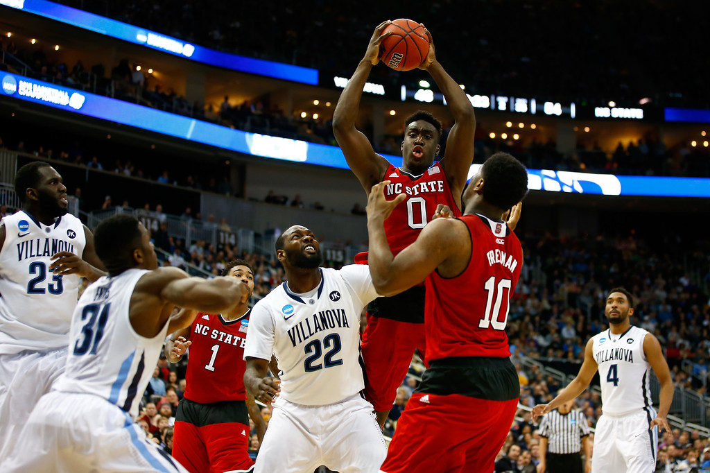 . Abdul-Malik Abu #0 of the North Carolina State Wolfpack pulls in a rebound in front of JayVaughn Pinkston #22 of the Villanova Wildcats in the second half during the third round of the 2015 NCAA Men\'s Basketball Tournament at Consol Energy Center on March 21, 2015 in Pittsburgh, Pennsylvania.  (Photo by Jared Wickerham/Getty Images)