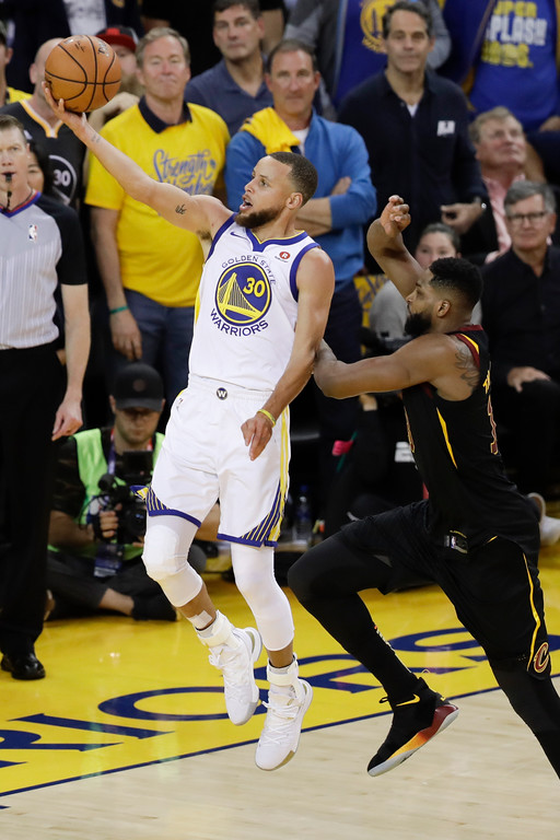 . Golden State Warriors guard Stephen Curry (30) shoots against Cleveland Cavaliers center Tristan Thompson during overtime of Game 1 of basketball\'s NBA Finals in Oakland, Calif., Thursday, May 31, 2018. The Warriors won 124-114. (AP Photo/Marcio Jose Sanchez)