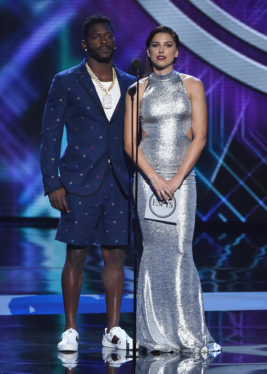 . Antonio Brown, left, and Alex Morgan present the award for best Olympic moment at the ESPY Awards at Microsoft Theater on Wednesday, July 18, 2018, in Los Angeles. (Photo by Phil McCarten/Invision/AP)