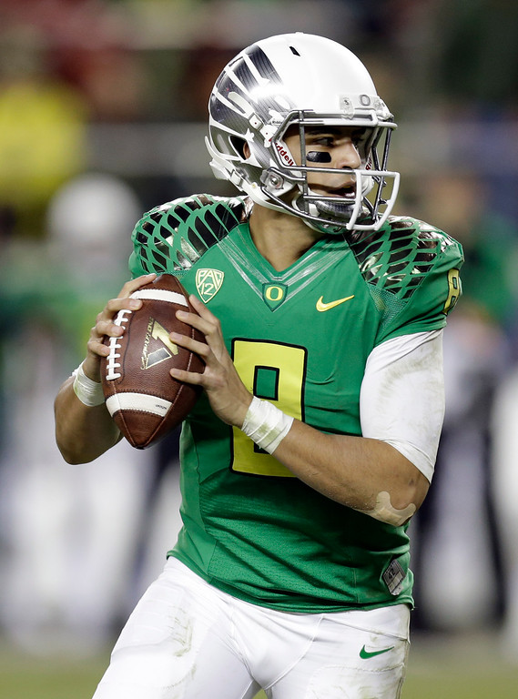 . Oregon quarterback Marcus Mariota drops back to pass against Arizona during the second half of a Pac-12 Conference championship NCAA college football game Friday, Dec. 5, 2014, in Santa Clara, Calif. Oregon won the game, 51-13. (AP Photo/Ben Margot)