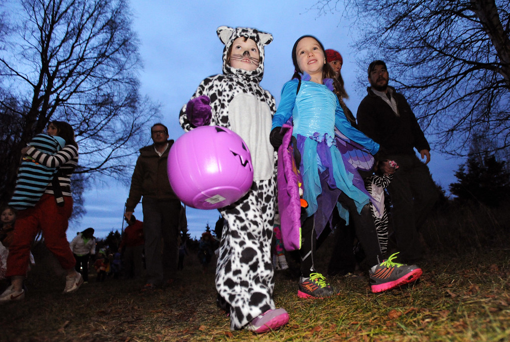 . In this Oct. 29, 2013 photo, kids and kids at heart took walk the trails at Kincaid Park to run in a 2K race during the Halloween costume run at the Bonny Sosa Tuesday Night Race Series in Anchorage, Alaska. (AP Photo/The Anchorage Daily News, Bill Roth)