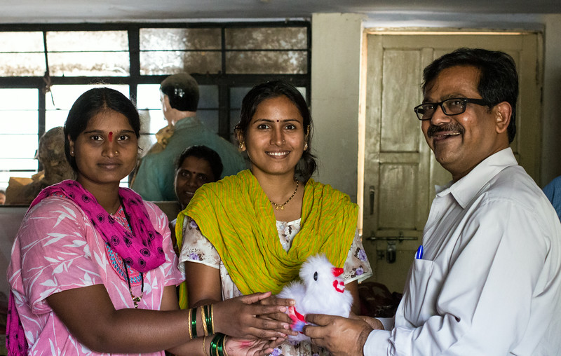 Ranjeet receives a stuffed turtle at the Global Communities center in Ramoshi Ali, a Pune slum.