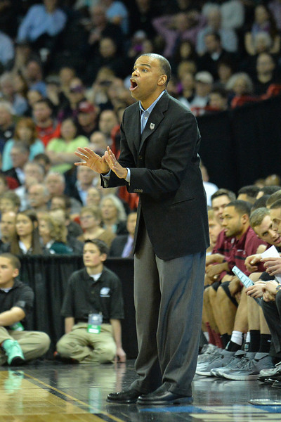 March 20, 2014: Harvard Crimson head coach Tommy Amaker shouts instructions to his team during a second round game of the NCAA Division I Men's Basketball Championship between the 5-seed Cincinnati Bearcats and the 12-seed Harvard Crimson at Spokane Arena in Spokane, Wash. Harvard defeated Cincinnati 61-57.