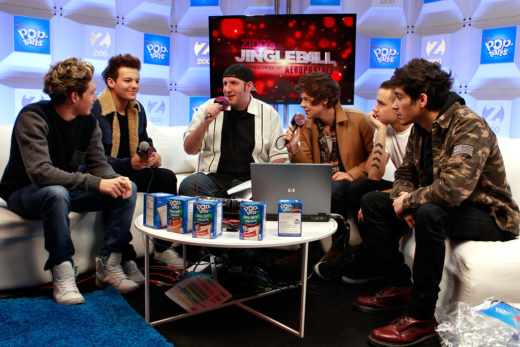. NEW YORK, NY - DECEMBER 07:  (L-R) Niall Horan, Louis Tomlinson, Harry Styles, Zayn Malik of One Direction and , Dj JJ attend the Z100 Artist Gift Lounge Presented by Pop Tarts at Z100\'s Jingle Ball 2012 at Madison Square Garden on December 7, 2012 in New York City.  (Photo by Mark Von Holden/Getty Images for Jingle Ball 2012)