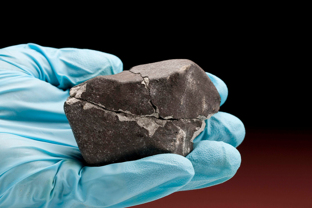 . In this 2010 photo released by the Smithsonian Institution\'s National Museum of Natural History, a meteorite the a size of a tennis ball is shown in Washington. The meteorite that plummeted through the roof of a Virginia doctor\'s office is drawing meteor hunters from across the country to Washington\'s Virginia suburbs. (AP Photo/Smithsonian Institution\'s National Museum of Natural History, Chip Clark)