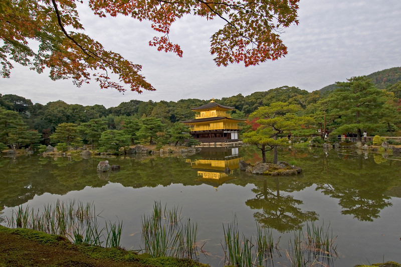 The Golden Pavilion surrounded by pond in Kyoto, Japan