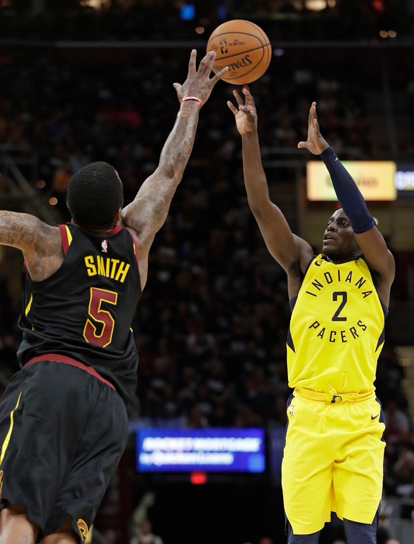 . Indiana Pacers\' Darren Collison (2) shoots over Cleveland Cavaliers\' JR Smith (5) in the second half of Game 1 of an NBA basketball first-round playoff series, Sunday, April 15, 2018, in Cleveland. (AP Photo/Tony Dejak)