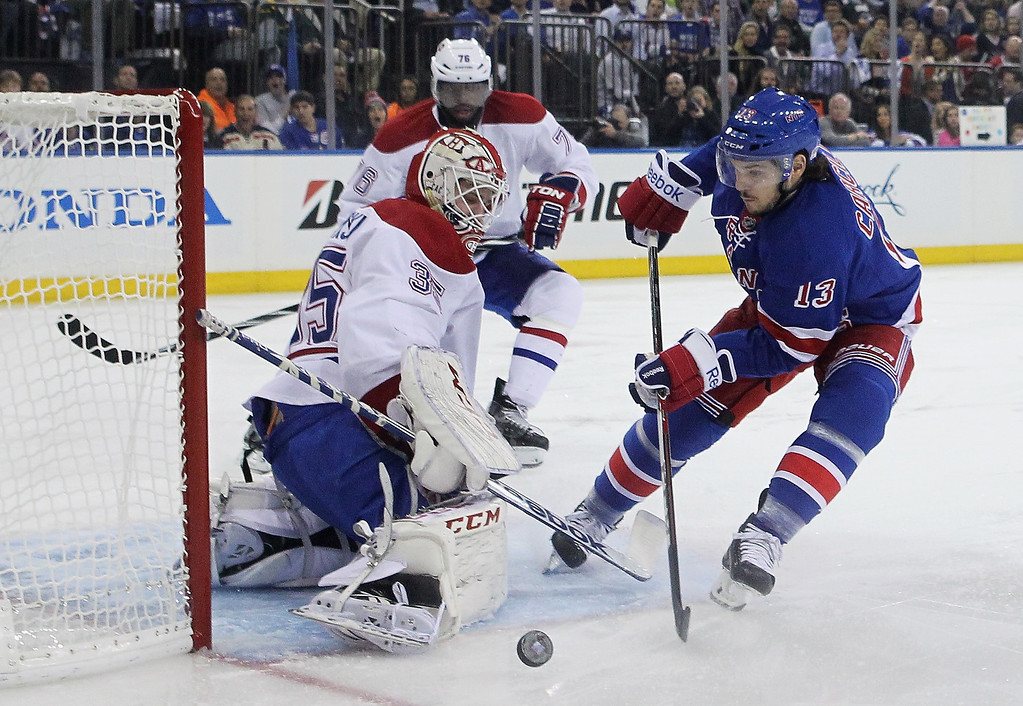 . Dustin Tokarski #35 of the Montreal Canadiens makes a save against Daniel Carcillo #13 of the New York Rangers in Game Three of the Eastern Conference Final during the 2014 NHL Stanley Cup Playoffs at Madison Square Garden on May 22, 2014 in New York City.  (Photo by Elsa/Getty Images)