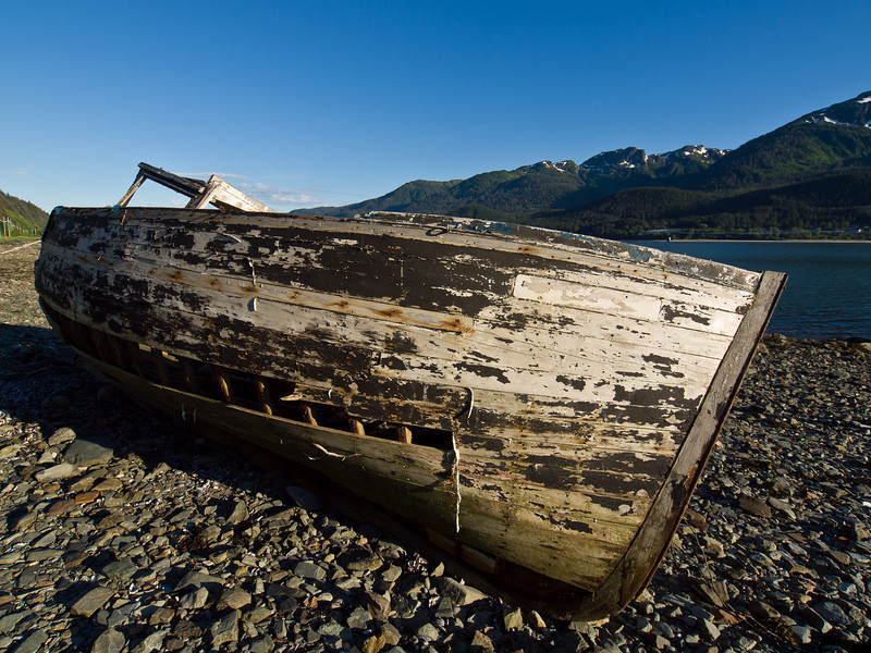 Old boat at a wide angle, looking like an abandoned ark.