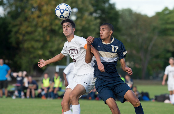09/24/19 Wesley Bunnell | StaffrrNewington boys soccer defeated New Britain 3-1 on Tuesday afternoon at Newington High School. New Britain's John Morell (8) and Newington's Youseff Khadrani (17) fight for the pass.