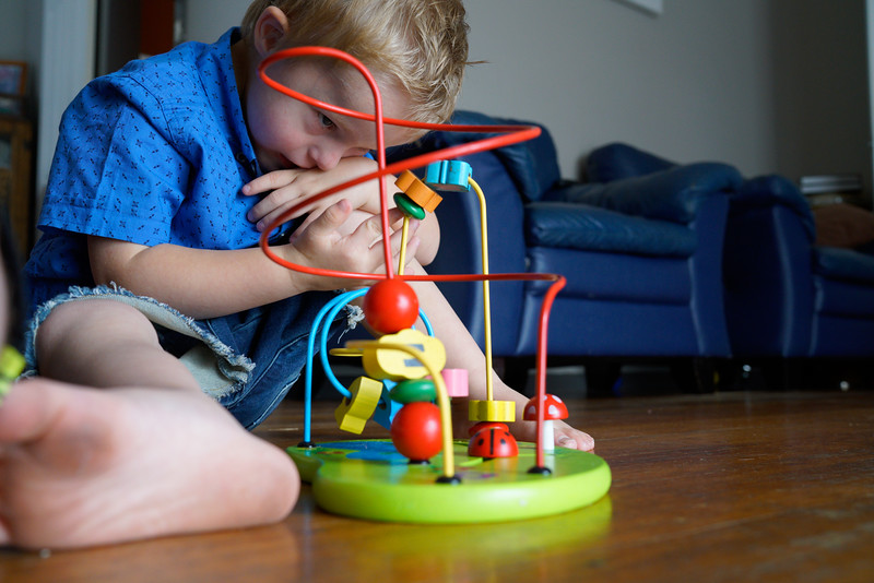 Little Boy playing with an Educational Toy