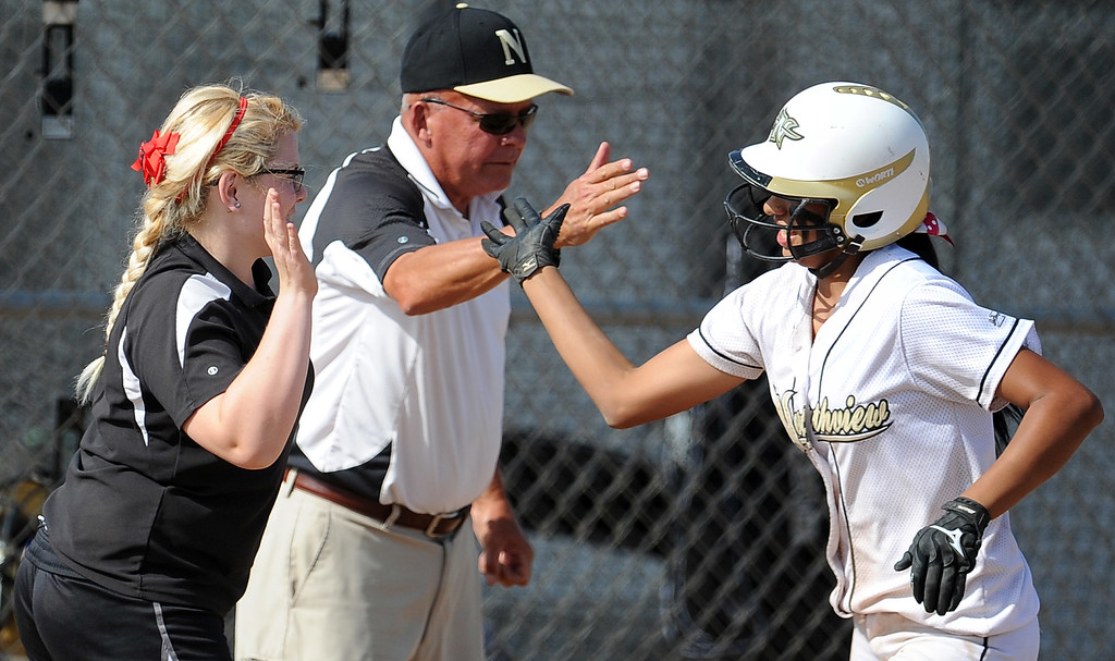 . Northview\'s Jocelyn Marquez high fives Northview\'s Jeffrey Butler, center, and an unidentified coach after hitting a solo home run in the sixth inning of a CIF-SS quarterfinal playoff softball game against Barstow at Northview High School on Thursday, May 23, 2013 in Covina, Calif. Northview won 5-4.  (Keith Birmingham Pasadena Star-News)