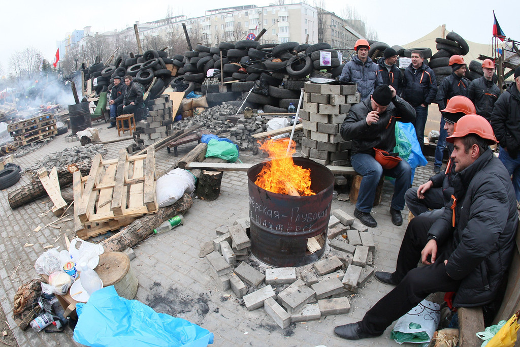 . Pro-Russian protesters guard a barricade outside the regional state building in the eastern Ukrainian city of Donetsk on April 14, 2014.    AFP PHOTO / ALEXANDER  KHUDOTEPLY/AFP/Getty Images